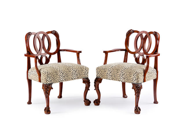 A pair of Australian mahogany and upholstered armchairs in the George II style by Francis De Groot