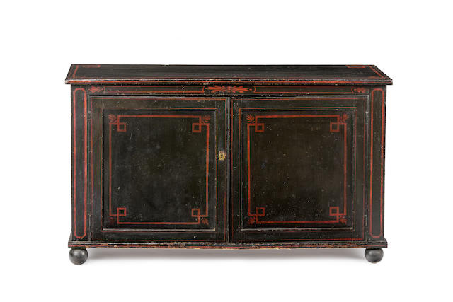 A Regency black painted two door side cabinet Circa 1810