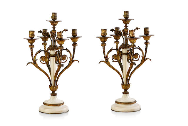 A pair of late 19th century Italian white marble and gilt bronze five light candelabra