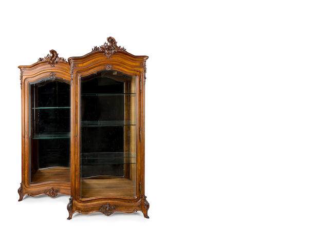 A pair of French Louis XV style walnut armoires, converted to display cabinets Circa 1900