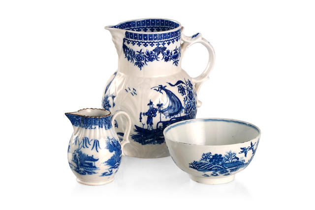 A Worcester cabbage leaf jug together with a sparrow beak creamer and a blue and white bowl Circa 1775