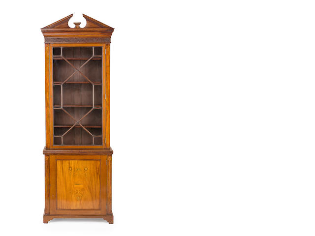 A Sheraton style inlaid mahogany narrow bookcaseEnglish, 19th century