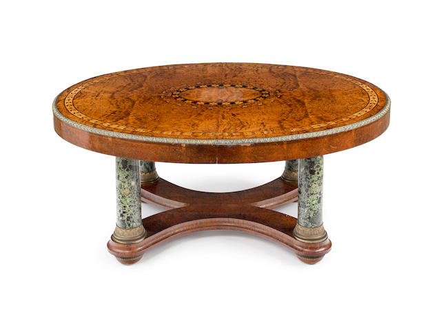 A 19th century North European   inlaid thuya wood and marble centre table