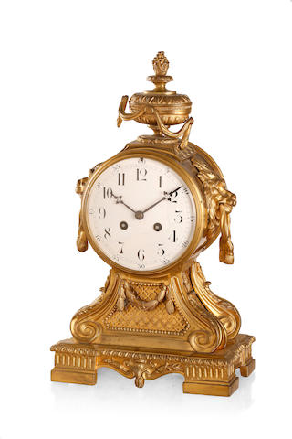 A 19th century French gilt bronze mantel clock  by Machenaud Paris