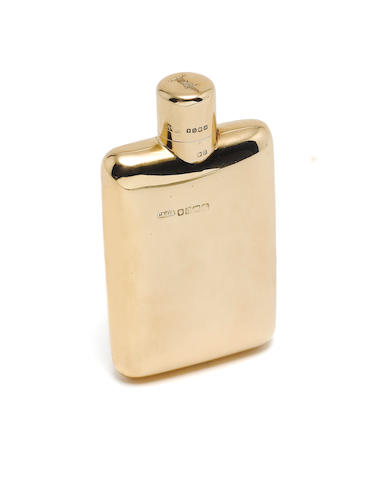 ASPREY: An 18 carat gold small spirit flask by Charles & George Asprey, London 1903