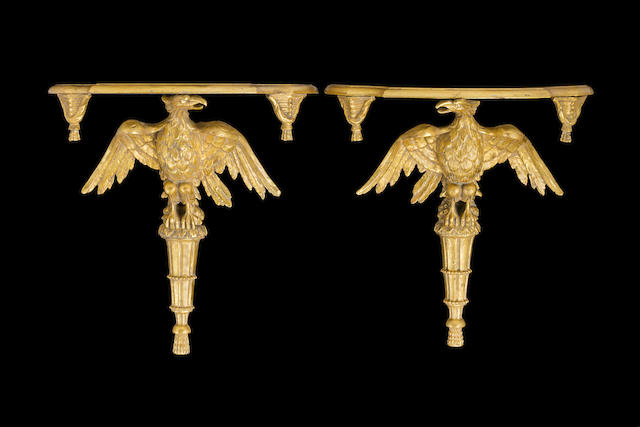 A pair of Regency style carved giltwood eagle wall brackets English late 19th century