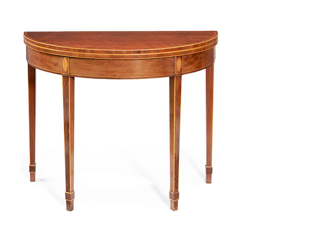 A late George III plum pudding mahogany and fruitwood inlaid demi-lune tea table