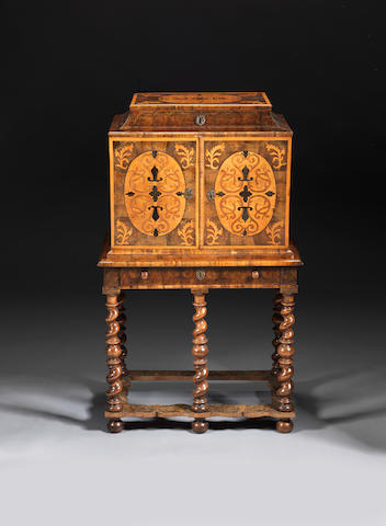 A Charles II oyster-veneered olivewood, marquetry and embroidered raised work cabinet on a later stand