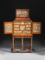 A Charles II oyster-veneered olivewood, marquetry and embroidered raised work cabinet