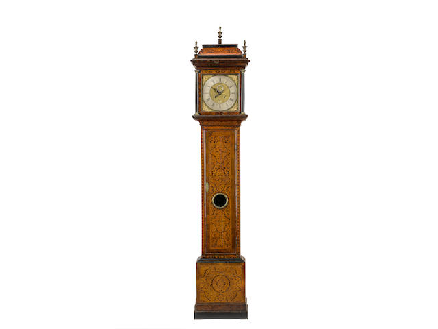 A large first quarter of the 18th century inlaid walnut longcase clock  by Thomas Trout