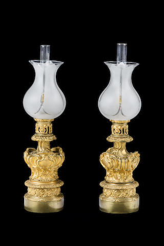 A pair of Rococo style gilt bronze moderator table lampsFrench early 19th century