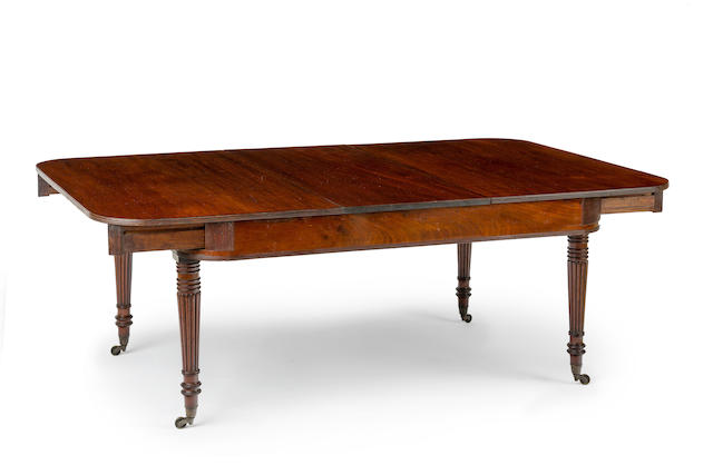 A Regimental Regency  mahogany extension dining table with three extra cedar leavesCirca 1825