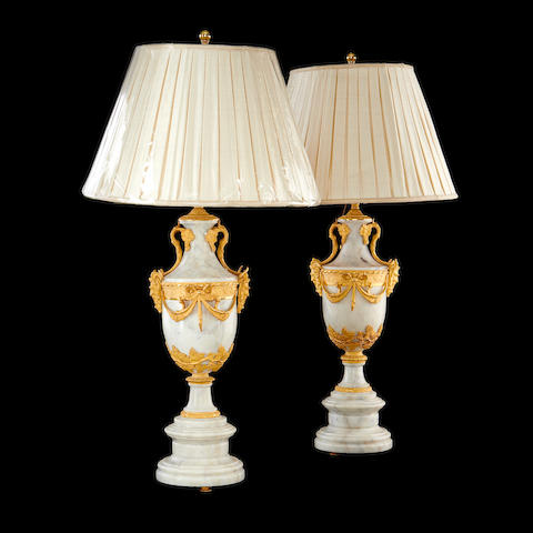 A pair of Louis XVI style marble and grey metal mounted lamp bases