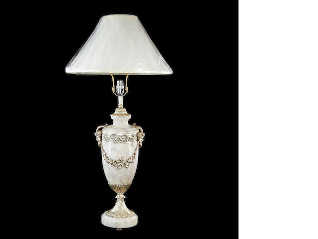 A Louis XVI style marble and silvered metal mounted lamp base