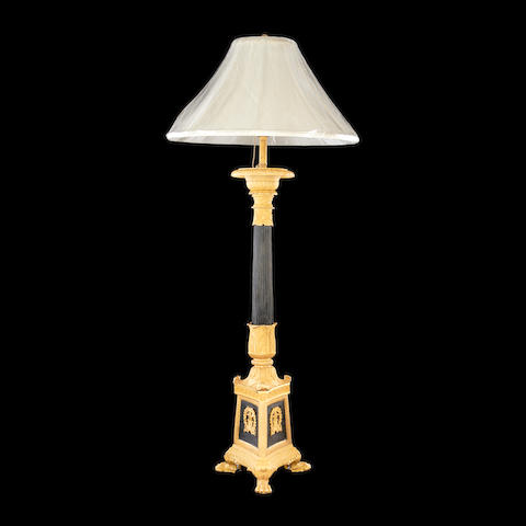 An Empire style gilt and patinated bronze lamp base