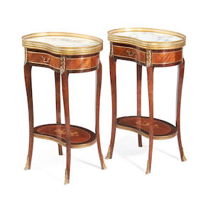 A pair of French stained beech and fruitwood inlaid kidney shaped occasional tables in the Transitional style