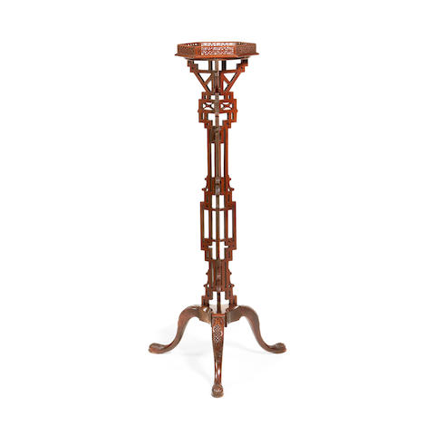 A late 19th/early 20th century mahogany torchere in the George III taste