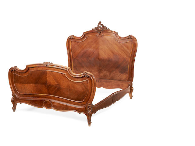 A French early 20th century walnut bed in the Louis XV style