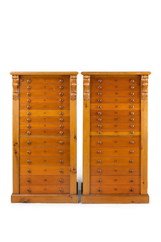 A large pair of  pine Wellington specimen cabinets Early 20th century