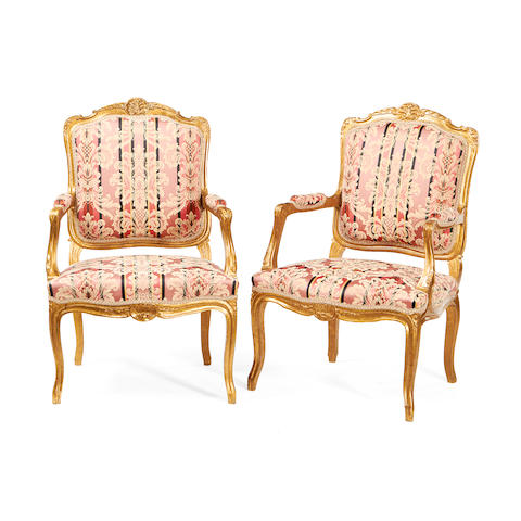 A pair of French late 19th century giltwood fauteuils in the Louis XV style