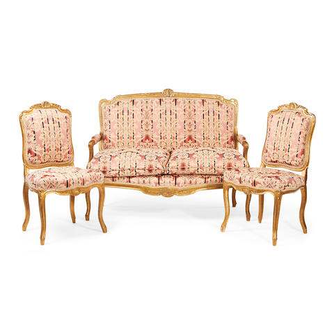 A three piece set of French late 19th century giltwood salon furniture in the Louis XV style