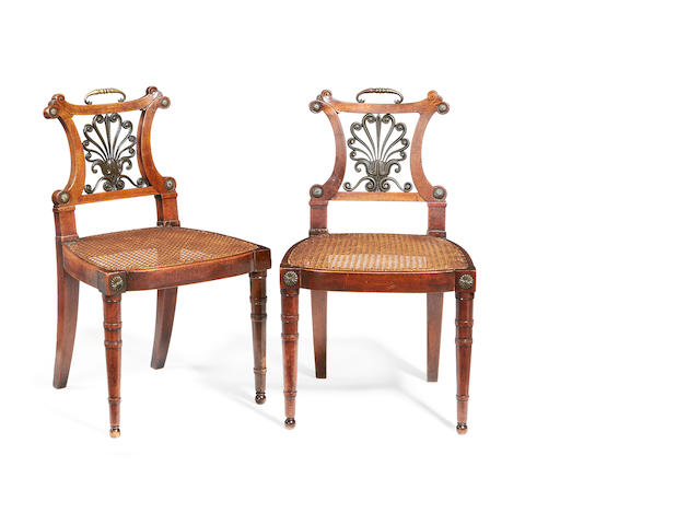A pair of Regency mahogany, brass mounted and bronze hall chairs