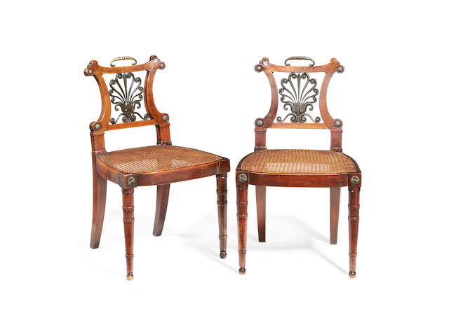 A pair of Regency brass and bronze mounted mahogany hall chairs