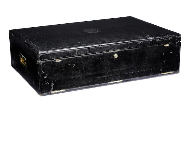 An early black leather motoring flat-trunk, by P & F Schafer, Piccadilly, London,