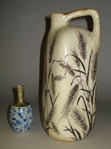 A Martin Brothers jug and a miniature vase