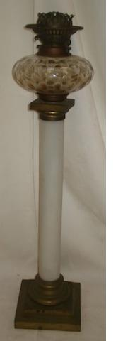 A 19th Century oil lamp, the cut glass reservoir on white glass column and square stepped base, 70cm.