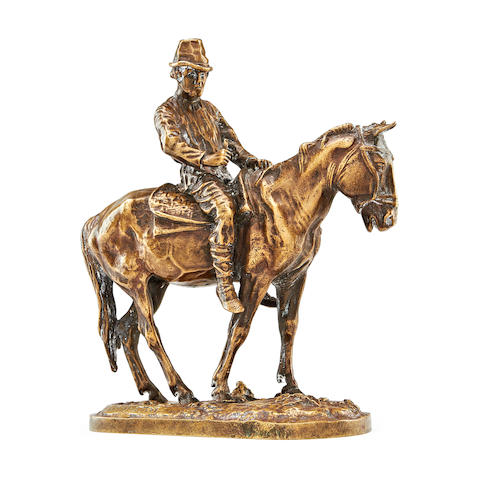 A late 19th century Russian bronze of a peasant on horseback