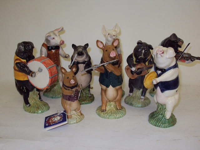 A set of nine Beswick 'Pig Promenade' figures