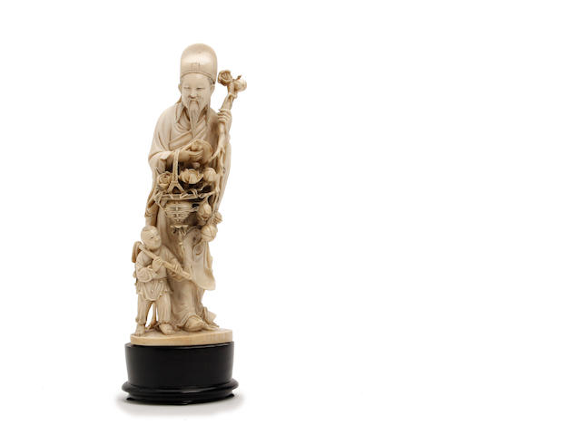 A Chinese ivory figure of a scholar collecting lotus flowers  19th Century