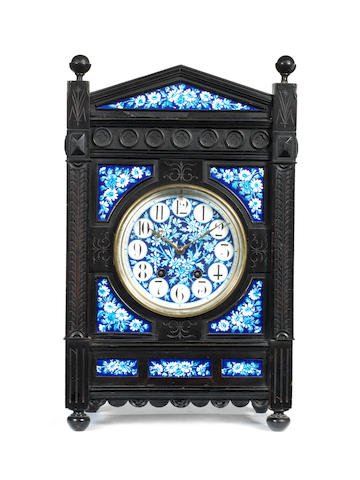 A large porcelain set ebonised clock,
