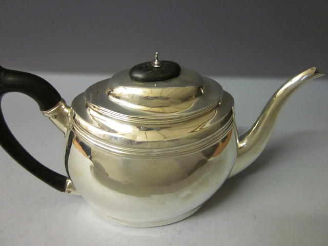 A George III silver teapot, maker S H in rectangle London 1800,