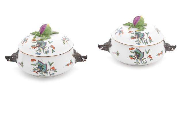 A pair of Meissen shallow tureens and covers with boar's head handles