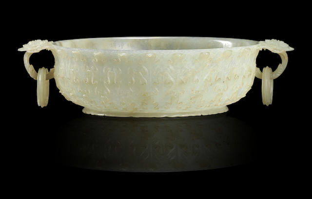An Imperial inscribed Mughal-style white jade 'chrysanthemum' bowl Qianlong, Imperially incised poem dated to 1790