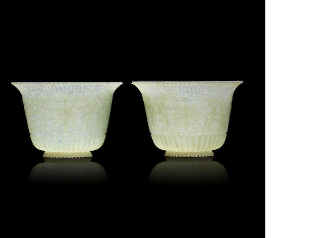 A fine pair of 'chrysanthemum' jade bowls Qing dynasty