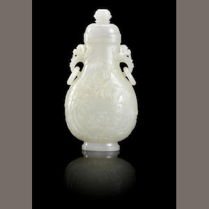 A white jade 'deer and crane' vase and cover