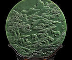 An Imperial spinach green jade 'tiger hunt' circular screen Qianlong