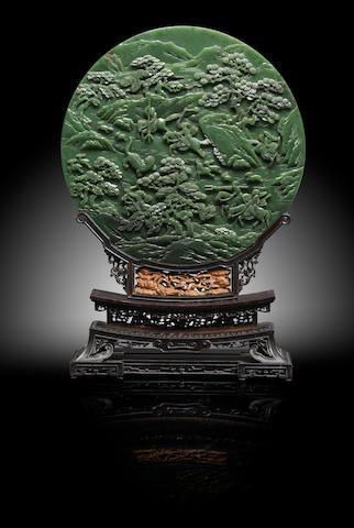 An Imperial spinach green jade 'tiger hunt' circular screen Qianlong