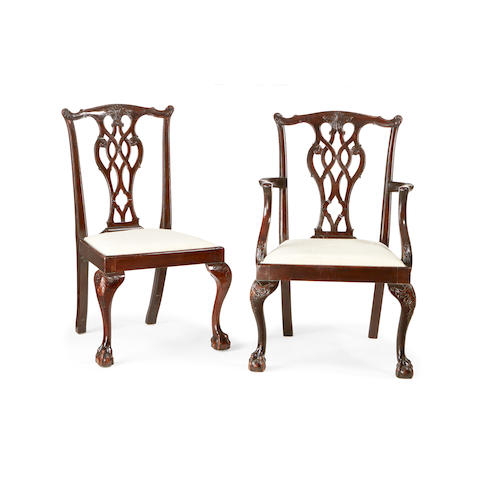 A matched set of twelve Chippendale style mahogany dining chairs, inclding a pair of carvers