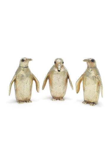 ASPREY: A novelty matched silver-gilt  'Penguin family' condiment set the peppers, by Asprey & Co, London 1961, the mustard, by Ricahrd Comyns, London 1963   (3)