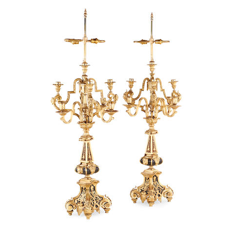 A pair of late 19th century gilt and patinated metal candelabra adapted as lampbases
