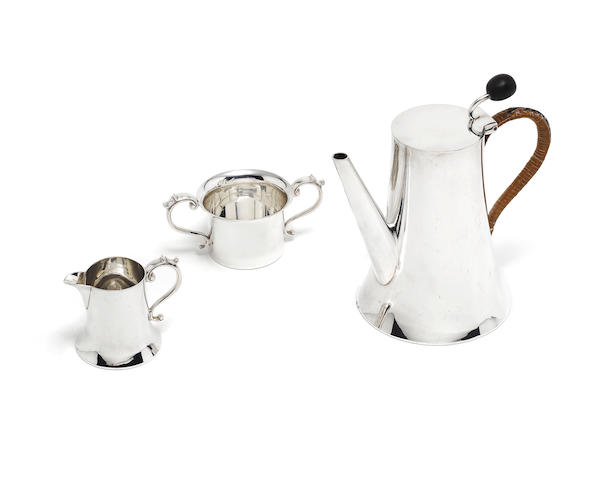 A  silver bachelor's three piece coffee set by Henry Wilkinson, Sheffield 1906; together with a coffee pot and a silver cigar box  (5)