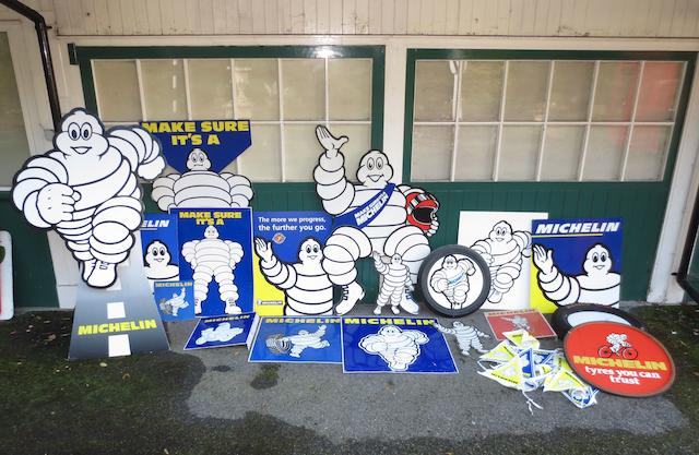 Assorted Michelin advertising signs,