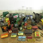 Assorted oil pourers and tins,