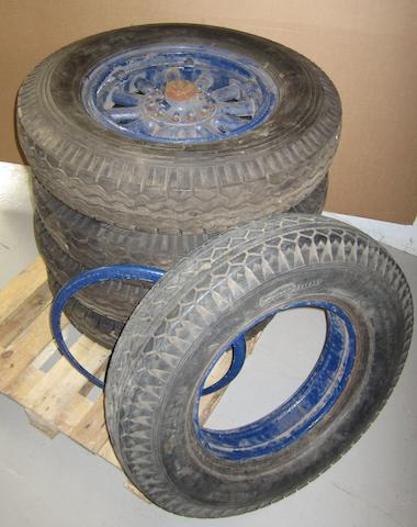 A set of four wheels and tyres, originally fitted to a 1926 Chrysler,