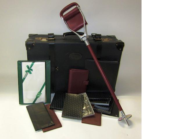 A Bentley suitcase and other leather goods