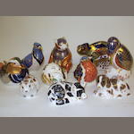 A collection of Royal Crown Derby paperweights